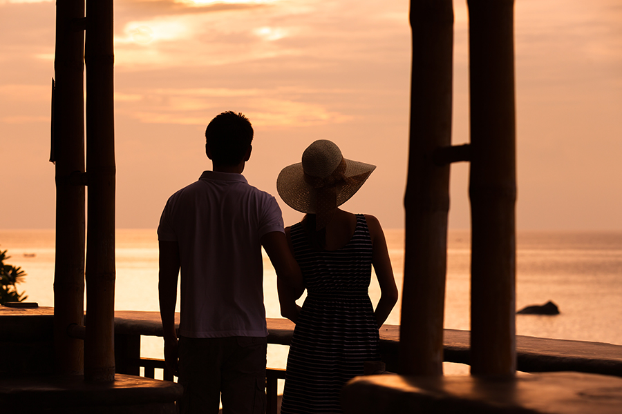 A happy couple watching a sunset on the Outer Banks and enjoying addiction recovery