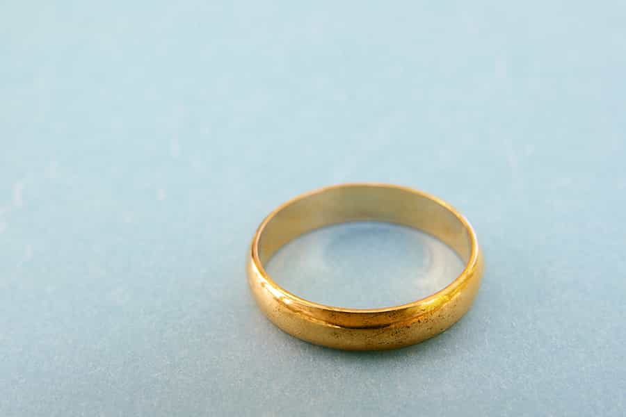 A wedding ring removed from the finger