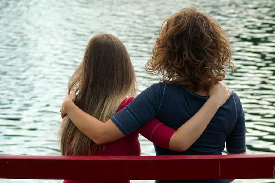 Two women hugging each other in addiction recovery