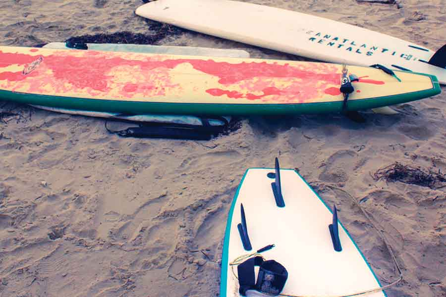 Enjoy surfing, paddle-boarding, and other water activities at the beach on the Outer Banks.
